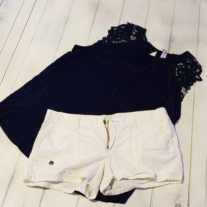 White shorts-blue blouse